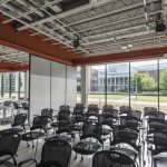 Caddell's cantilevered canopy provides 100 percent day-lighted views of occupied spaces. Inside, exposed ceilings serve as educational tools on building construction. Photo from Bldgs.